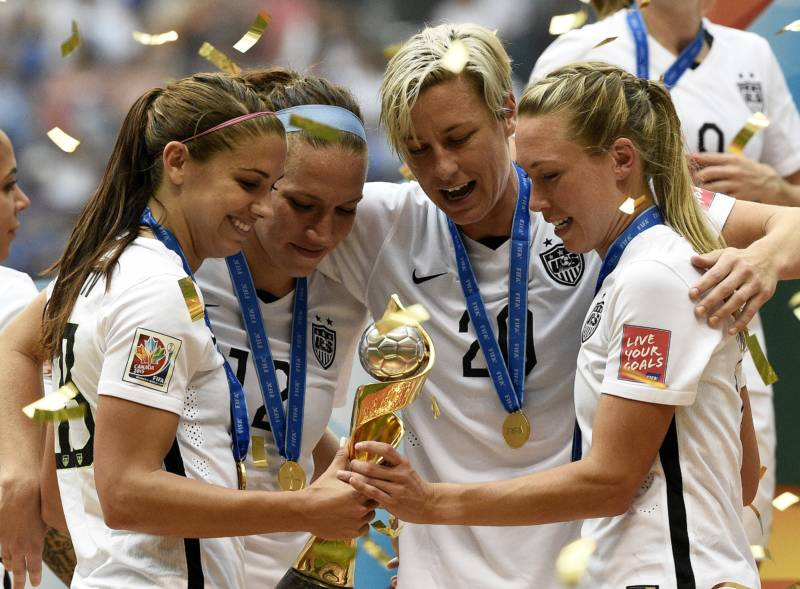 (L-R) Alex Morgan, Lauren Holiday, Abby Wambach and Whitney Engen celebrate after winning the final 2015 FIFA Women's World Cup match in Vancouver, July 5, 2015.