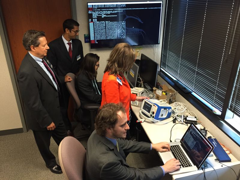 Clinical Information Security Director Kevin McDonald (left) at Mayo Clinic in Minnesota leads a team checking medical devices for software vulnerabilities that could cause a device to be infected with malware or exploited by hackers.