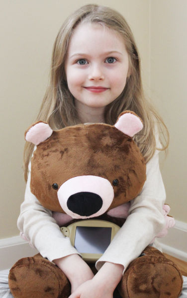 Caylin Proffitt with Jerry, her 'smart' bear and dietary consultant.
