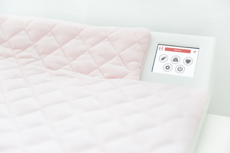 The Smart Pad changing table allows parents to track weight, diaper contents, and other metrics.