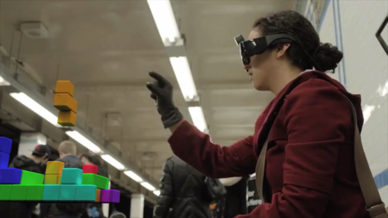 This still from a Meta promo video shows how the goggles allow users to manipulate virtual objects.