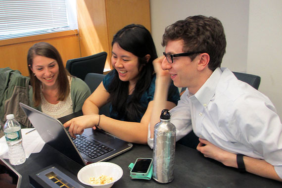 (Left to right) Christine Schindler, Mary Quien and Micah Timen hold a study session. Timen worked as an accountant before medical school; his database project tracked the relative costs of a hip replacement throughout New York compared to the relative costs of a fast-food hamburger.