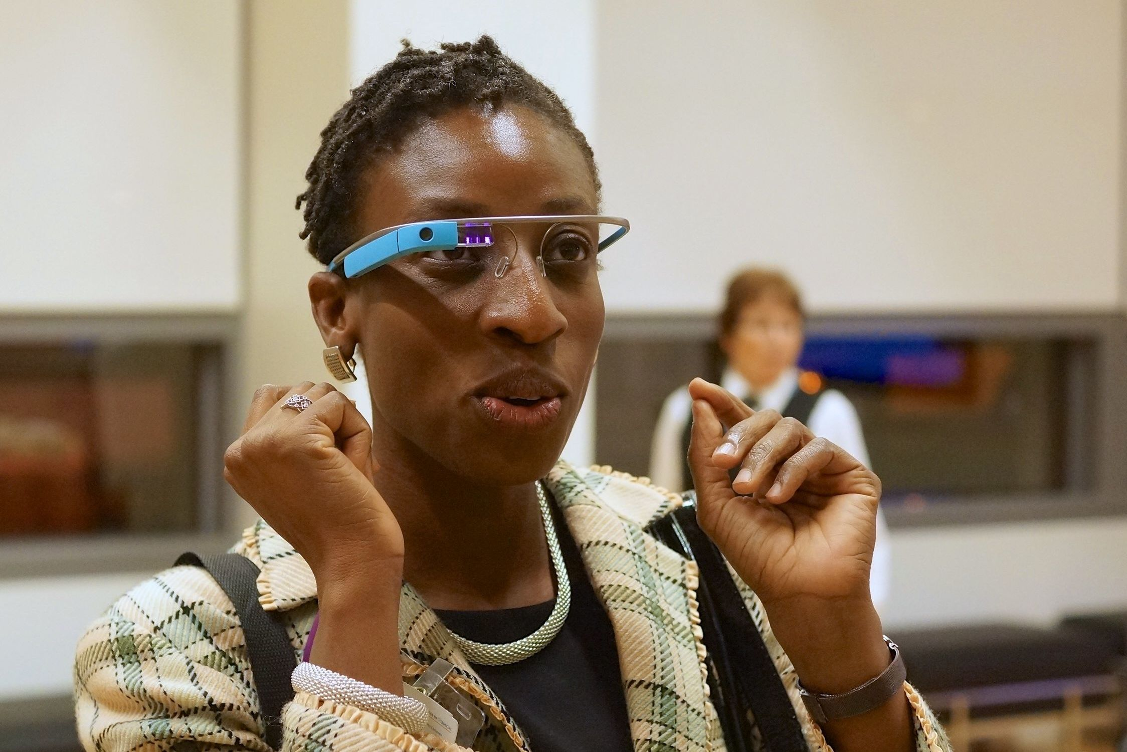 Dr. Tawakalitu Oseni checks out Google Glass at a meeting of the American College of Surgeons in 2013. Oseni is a surgical oncologist at the Naval Medical Center San Diego.