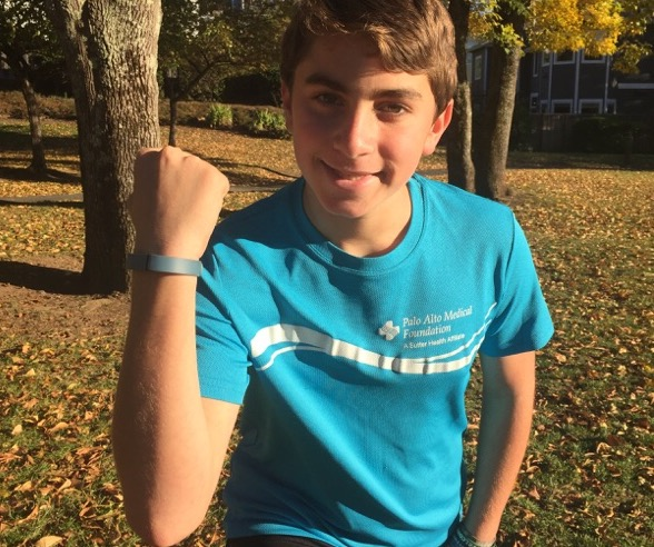 Zachary Berston, 12, says his FitBit encourages him to get out more.