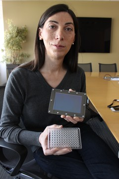 Emily Leproust, co-founder of Twist Bioscience, holds one of the company's 10,000-well plates in her left hand.