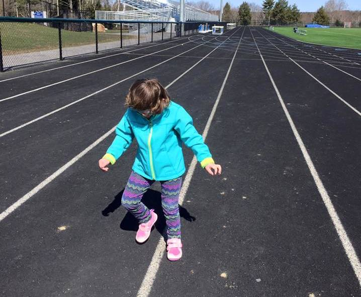 Tess Bigelow stomps it out on the track where she competed in the Special Olympics.