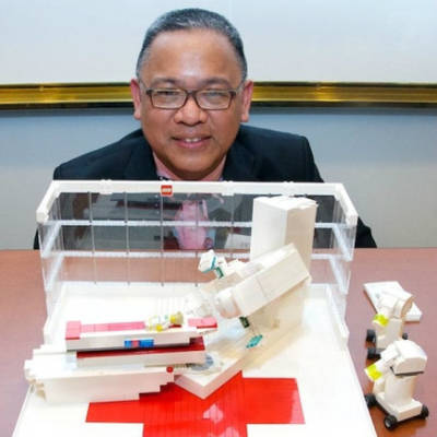 Oncology nurse Victor Ty built a lego model of a linear accelerator machine.