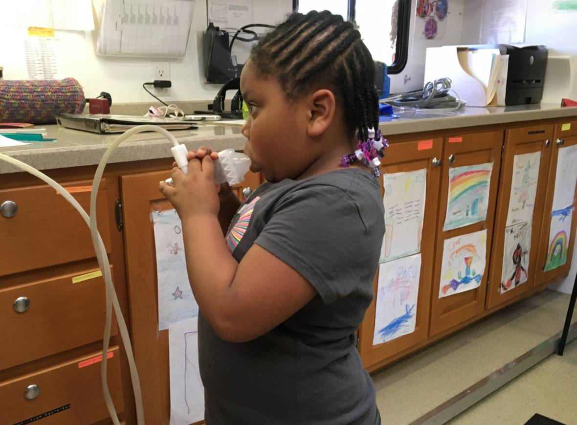 A lung test on the Breathmobile reveals five-year-old Brooklyn's pulmonary function is compromised by her asthma.