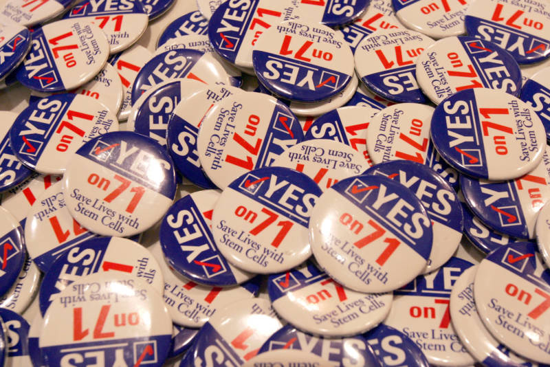 Buttons with the slogan 'Save Lives With Stem Cells,' in support of Prop. 71 at the Stem Cell Research Proposition Party at the Biltmore Hotel Nov. 2, 2004 in Los Angeles, California.