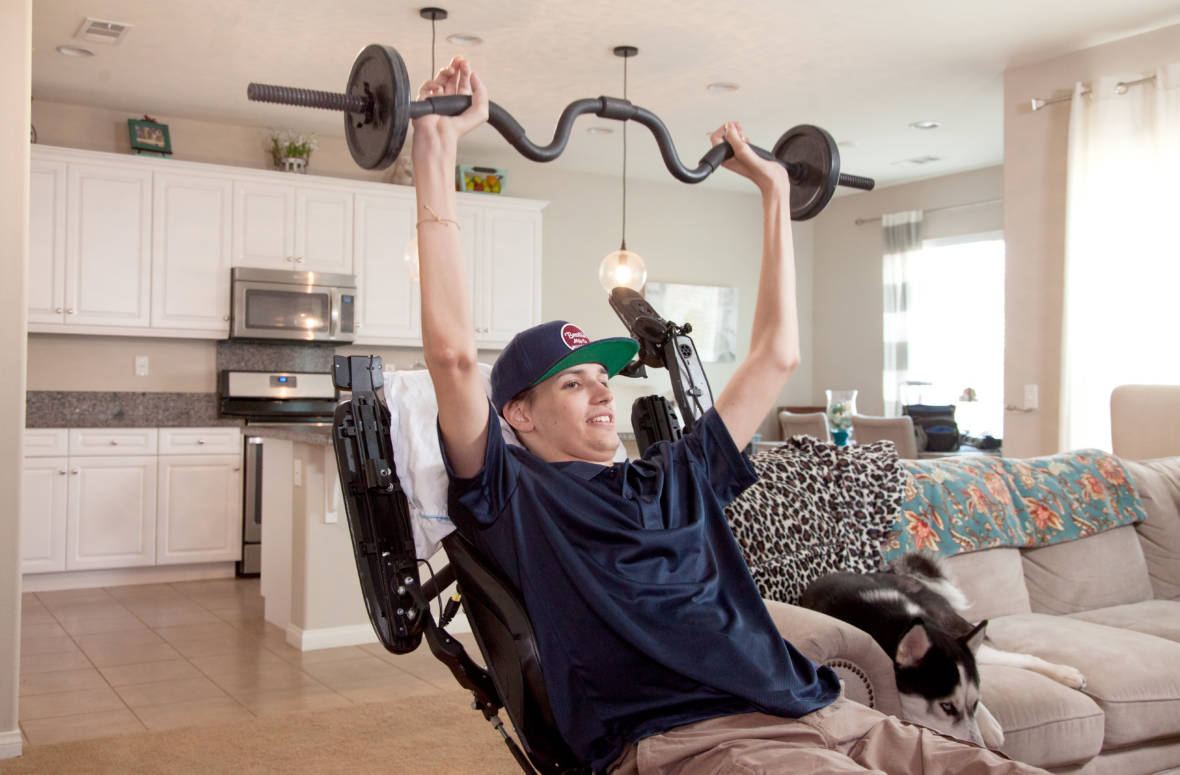 Lifting weights is part of Kris Boesen's regular program of physical therapy.