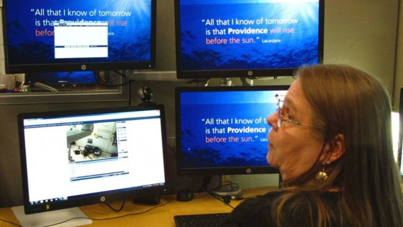 Intensive care unit nurse Deborah Springer in Anchorage, Alaska, demonstrates the focusing ability of a telemedicine camera that is part of a new telemedicine partnership between the Iliuliuk Family and Health Services on Unalaska Island and Providence Alaska Medical Center.