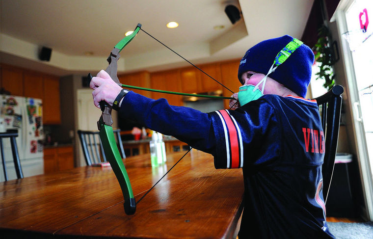 Josh Hardy takes aim at his brother Jude while playing at home. He died in September 2016.