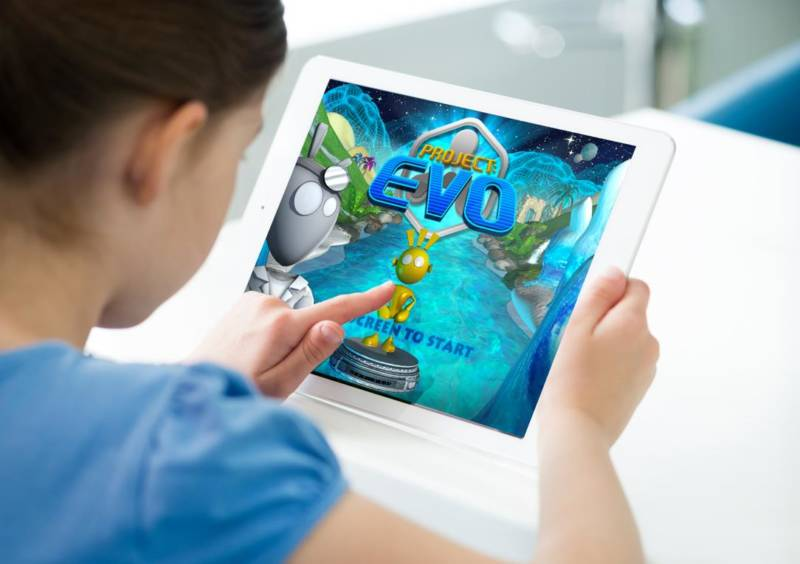 A child plays with Project: EVO, a video game software.
