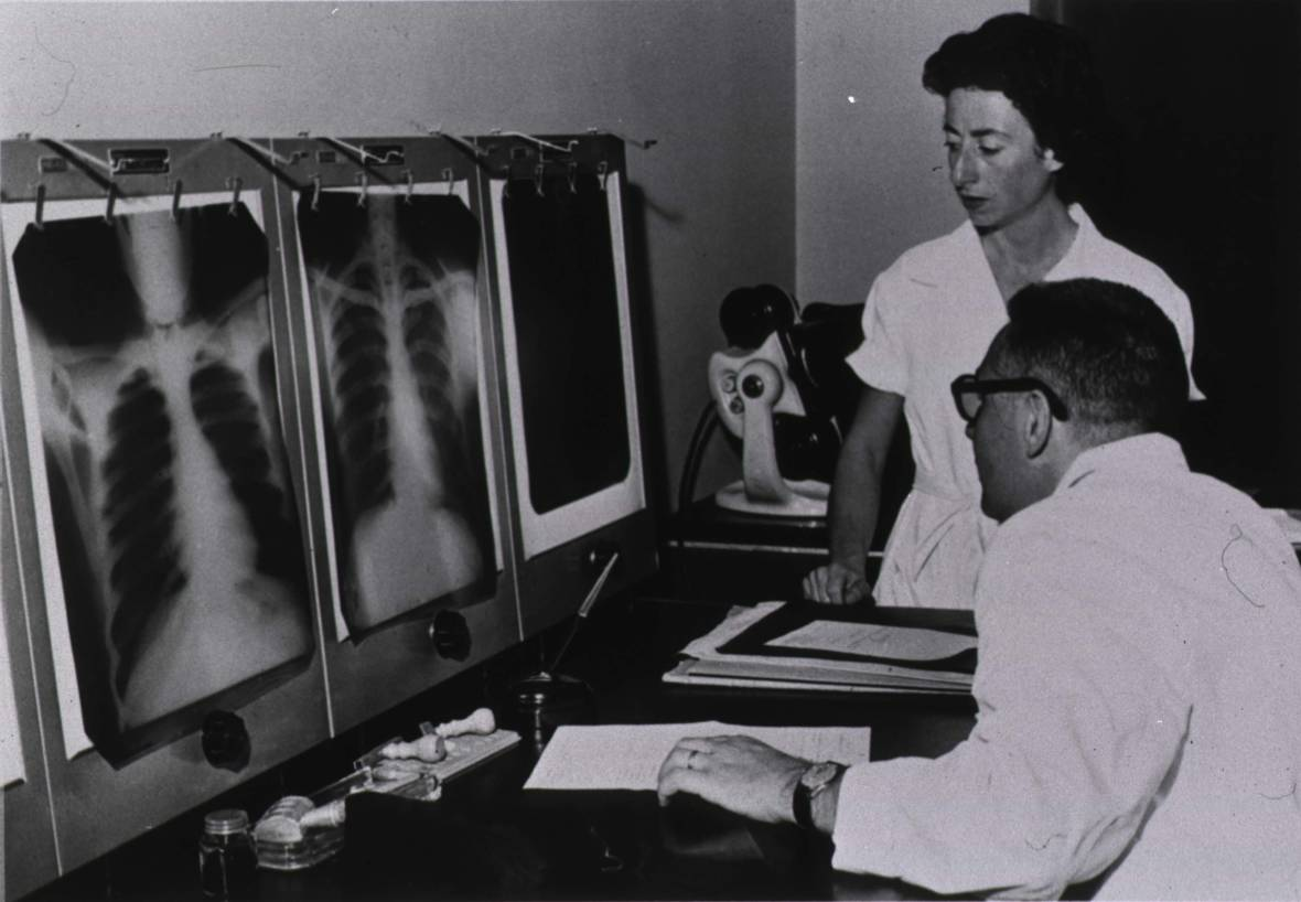 """A doctor and nurse read X-ray films, circa 1959. From the History of the Public Health Service,"""" Parklawn Conference Center, 1989"""