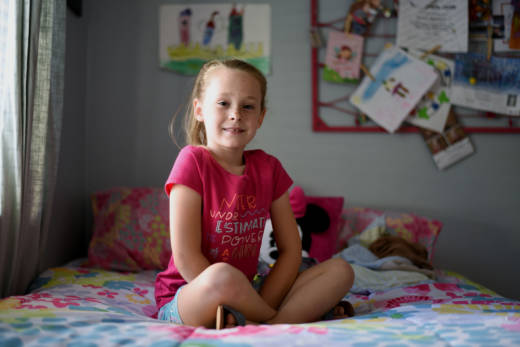 d38b7174597 Gracie, 7, poses for a picture in her room. Gracie is transgender; she  socially transitioned to a girl at the age of 4. (Lauren Hanussak/KQED)