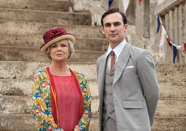 Left to right: Julie Walters as Cynthia Coffin and Henry Lloyd-Hughes as Ralph Whelan. ((C) New Pictures and Channel 4 for MASTERPIECE in association with All3Media International)