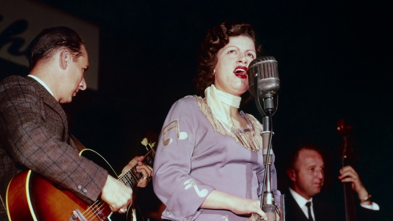 Archival still of Patsy Cline performing in Ken Burns' Country Music documentary series.