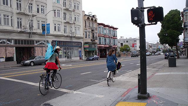 riding bikes down an empty Valencia street