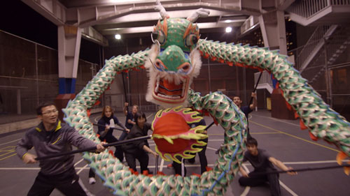 """The Kei Lun team practices a dragon dance. """"The team must move as one,"""" Chan says. """"If one person on the team makes a mistake, the whole dragon dance stops."""""""