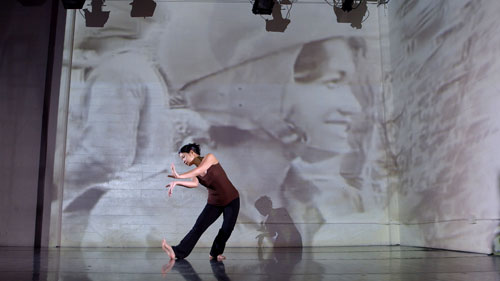 "Burt incorporates video imagery into her more contemporary work. Here she rehearses ""Silenced,"" which honors Cambodian pop icon Ros Sereysothea. Burt will perform the piece in San Francisco at CounterPULSE in March."
