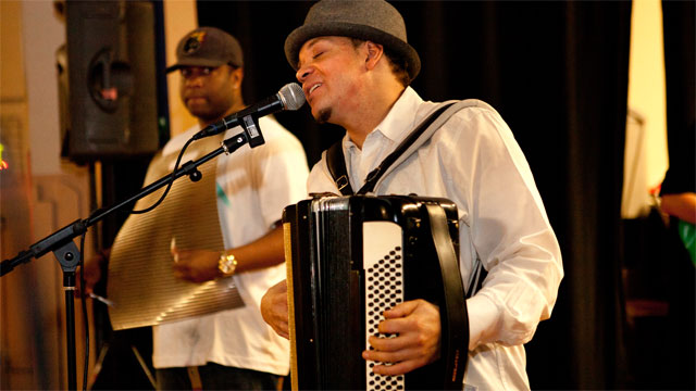Andre Thierry plays accordion with his zydeco band.