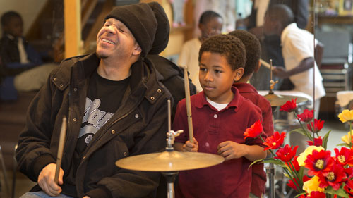 Thierry brings the zydeco tradition to a new generation. Here, Nicholas Gardner, 7, learns drums.