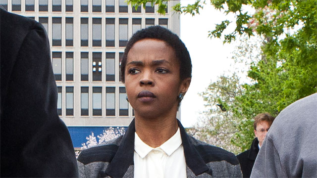 Lauryn Hill leaving court during her tax troubles