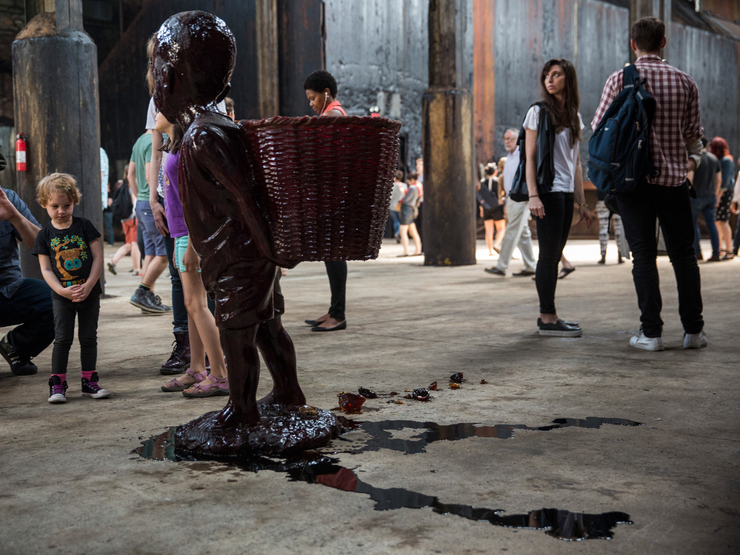 Walker's candy boy sculptures started melting fast in the non-climate-controlled factory, and the result looks a lot like blood