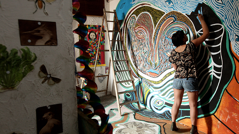 Visiting Peruvian artist Alexandra Wendorff paints in a friend's studio at the Tacheles artists' collective on August 2, 2010 in Berlin, Germany.