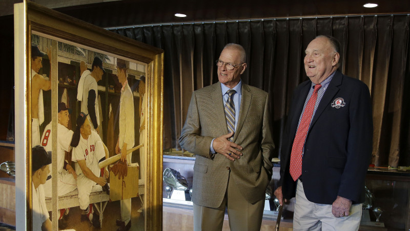 Two of the men who posed for Norman Rockwell's The Rookie — Frank Sullivan (right), the player with 8 on his back in the painting, and Sherman Safford, the rookie holding the suitcase — viewed the work at Fenway Park earlier this month. The painting was sold at auction Thursday
