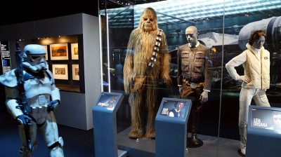 "Parts of the Lucas Cultural Arts Museum collection on display. The ""Star Wars Identities"" traveling exhibition, currently at the Cite du Cinema in Saint-Denis, France, features 200 objects from George Lucas' collection — including the costumes of Chewbacca, Han Solo and Princess Leia Organ"