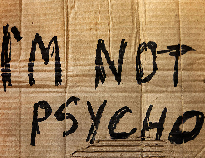 hitchhiking sign reads Im not psycho