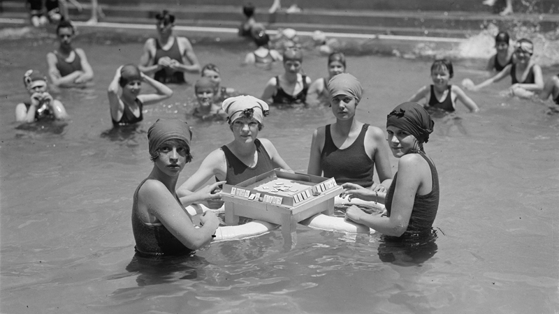Leisure-class ladies playing a floating game of mah jongg, 1924. Courtesy of Library of Congress, Prints and Photographs Division.