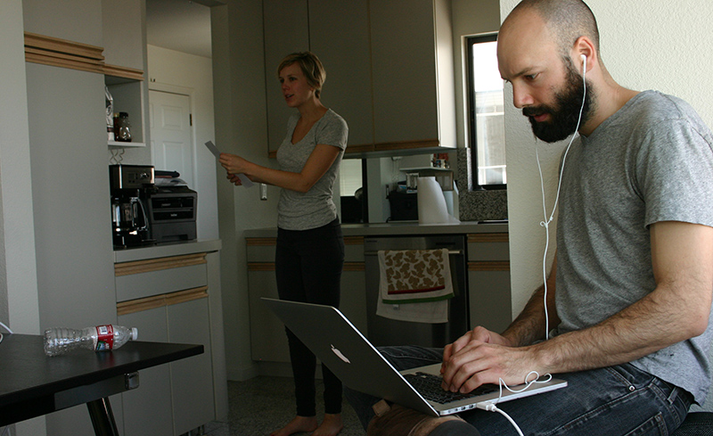 Patreon cofounder Jack Conte works in the living room of a Noe Valley apartment that served as the company's headquarters for eight months. His girlfriend and Pomplamoose bandmate, Nataly Dawn, is in the kitchen.