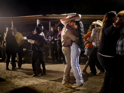 Sam Comen, Jose Saldana and Sandy Melendez share a dance in Lost Hills, CA. October 29, 2011
