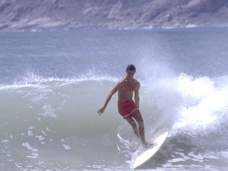 Robert August hits some waves off the coast of South Africa in <em>The Endless Summer </em>(1966). The film went on to inspire surfing communities all over the world.