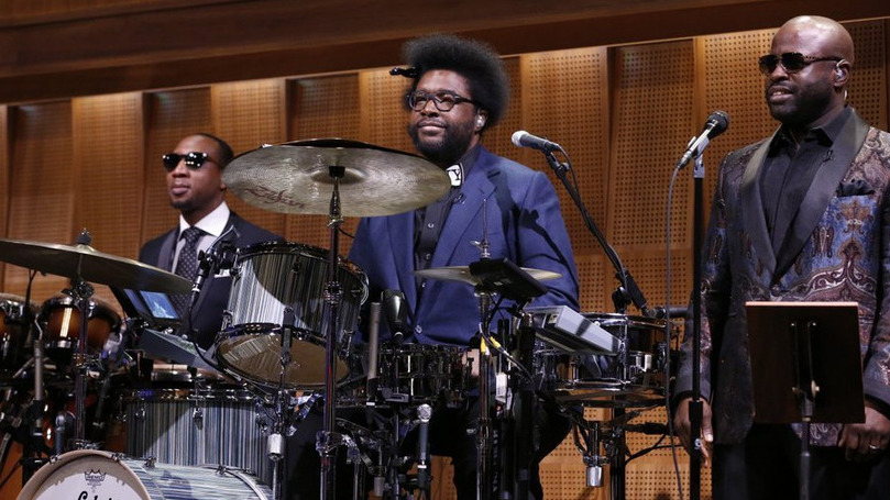 "Ahmir ""Questlove"" Thompson (center) appears with The Roots members Frank Knuckles (left) and Tariq ""Black Thought"" Trotter during the first episode of The Tonight Show Starring Jimmy Fallon."
