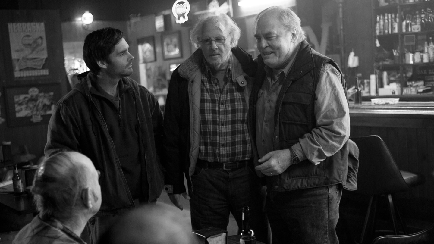 David (Will Forte, left) and his father, Woody (Bruce Dern, center), take time out of their quixotic journey to stop in Woody's small Nebraska hometown — where Woody's old business partner, Ed (Stacy Keach), is still nursing a grudg