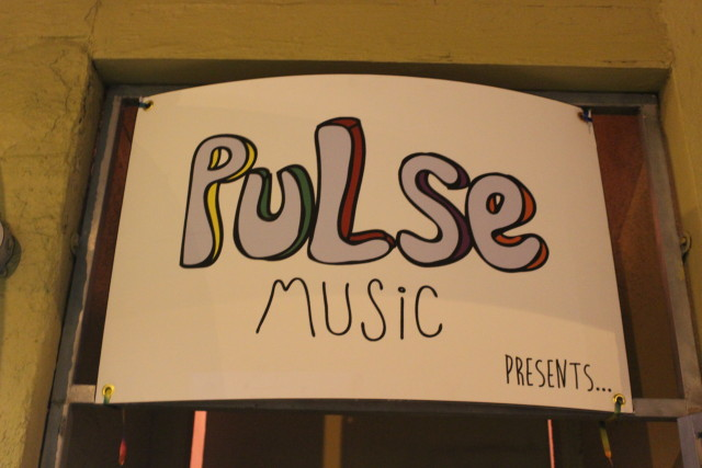 Pulse Music SF banner shown at the entrance to their house show.