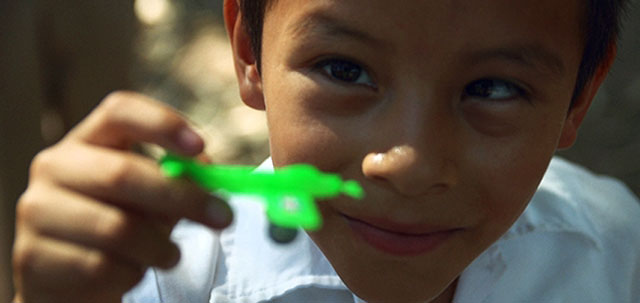 A Mexican child with his toy airplane