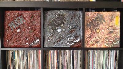 Musk album covers on record shelf
