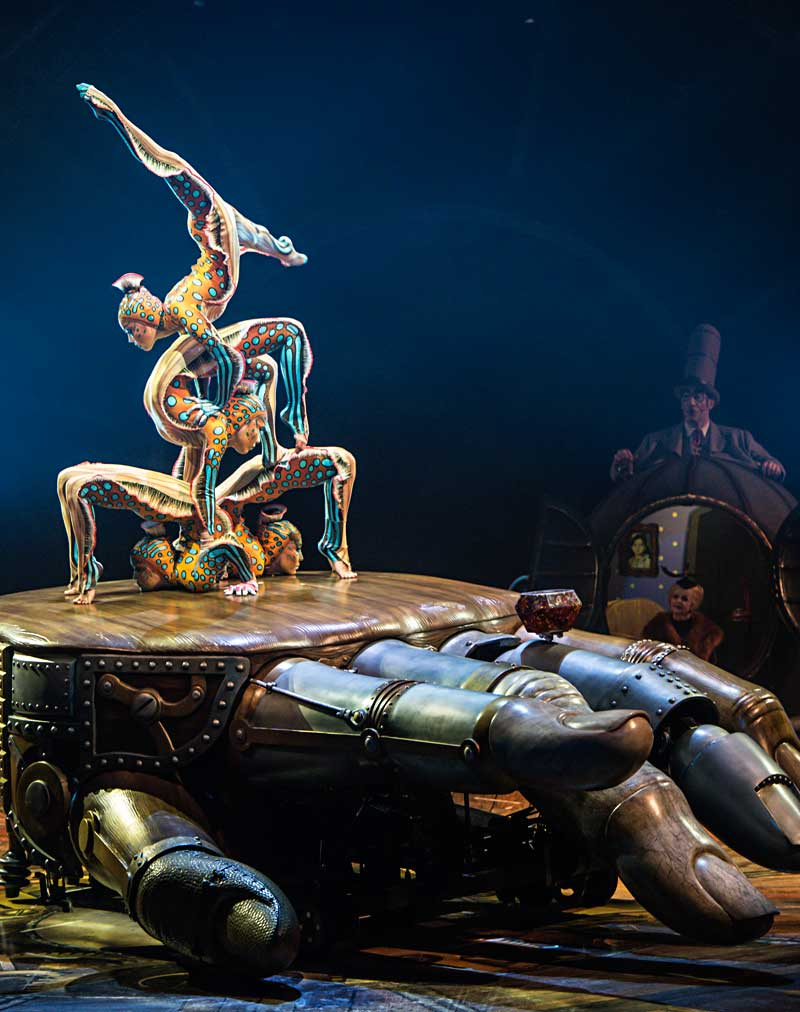 Contortionists dressed as undersea creatures move sinuously through a fluid show of control, flexibility and perfect synchronization.