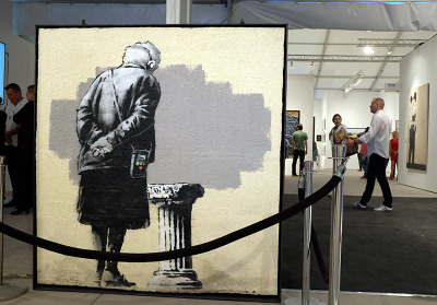 Artwork by Banksy at Art Miami; Photo by Cherri Lakey