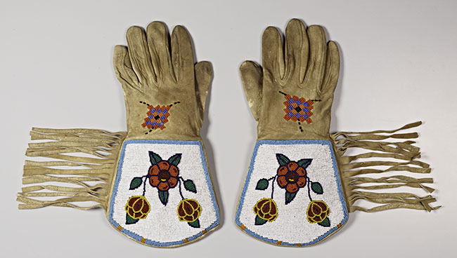 Unknown artist. Pair of gauntlet gloves, 1930; leather and glass beads. Courtesy of the Cantor Arts Center.