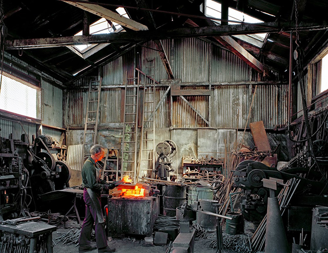 Johnny Ryan, Blacksmith, Klockar's Blacksmith and Metal Works, 443 Folsom Street, 1980. Photo by Janet Delaney