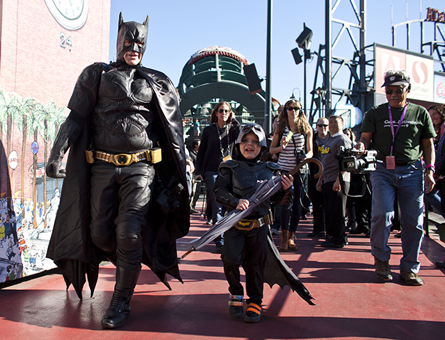 Leukemia survivor Miles, 5, dressed as BatKid, and Batman release the San Francisco Giants mascot from the Penguin as part of a Make-A-Wish foundation fulfillment at AT&T Park November 15, 2013 in San Francisco.   (Photo by Ramin Talaie/Getty Images)