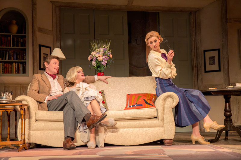 Charles (Charles Edwards) gets cozy with dead wife Elvira (Jemima Rooper) to the annoyance of second wife Ruth (Charlotte Parry) in Blithe Spirit.