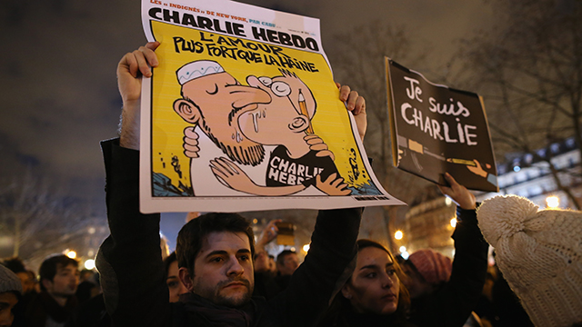 People hold a vigil at the Place de la Republique (Republic Square) for victims of the terrorist attack, on January 8, 2015  in Paris, France. Twelve people were killed yesterday including two police officers as two gunmen opened fire at the offices of the French satirical publication Charlie Hebdo.  (Photo by Dan Kitwood/Getty Images)