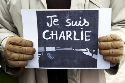 "A journalist holds a placard reading in French"" I am Charlie"" during a gathering on the streets of Pristina on January 8, 2015 in solidarity with the victims of the shooting at the Paris office of the satirical newspaper Charlie Hebdo which left 12 people dead. ARMEND NIMANI/AFP/Getty Images)"