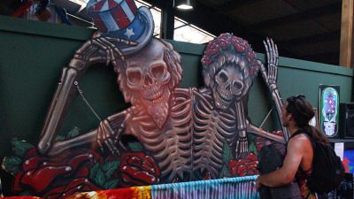 """Rock and Roll fans, known as """"Deadheads,"""" tour a memoriabilia display relating to the history of The Grateful Dead band, during a reunion performance at the Alpine Valley Music Center in East Troy, Wisconsin, late August 3, 2002."""